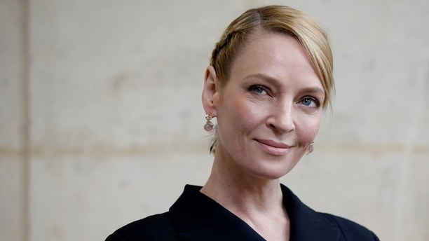 FILE PHOTO: Actress Uma Thurman poses during a photocall before the French fashion house Christian Dior Fall/Winter 2017-2018 women's ready-to-wear collection during Fashion Week in Paris, France, March 3, 2017. REUTERS/Gonzalo Fuentes/File Photo - RC15281B85D0