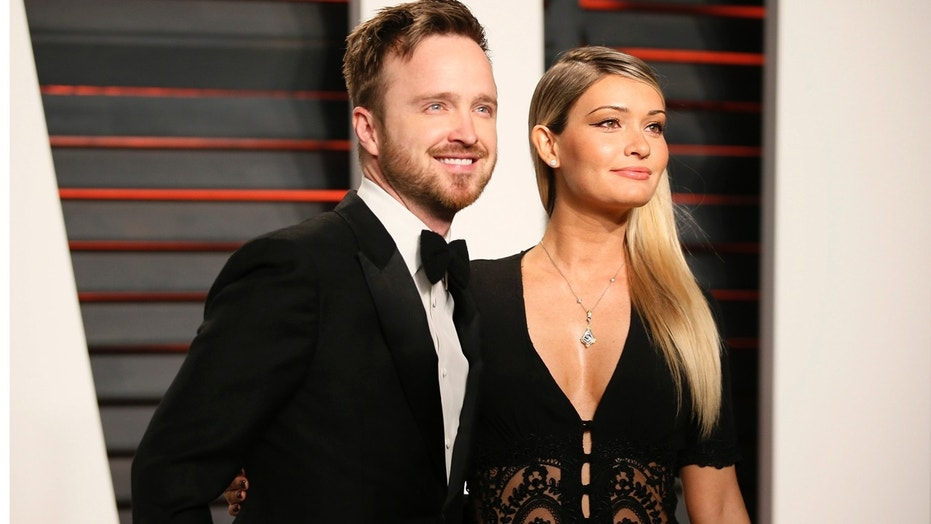 Actor Aaron Paul and his wife Lauren Parsekian arrive at the Vanity Fair Oscar Party in Beverly Hills, California February 28, 2016.