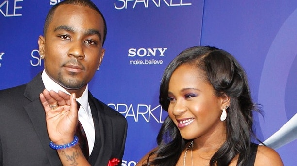 Bobbi Kristina Brown, daughter of the late singer Whitney Houston,  arrives with boyfriend Nick Gordon at the premiere of the new film 'Sparkle' in Hollywood August 16, 2012. Gordon said on Wednesday he tried to revive Brown after finding her in a bathtub last year.  REUTERS/Fred Prouser/File photo - RTX2BXD5