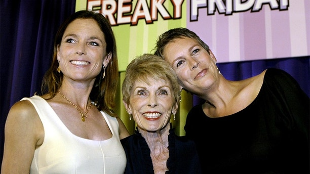 Cast member Jamie Lee Curtis (R) poses for photographs with her mother,