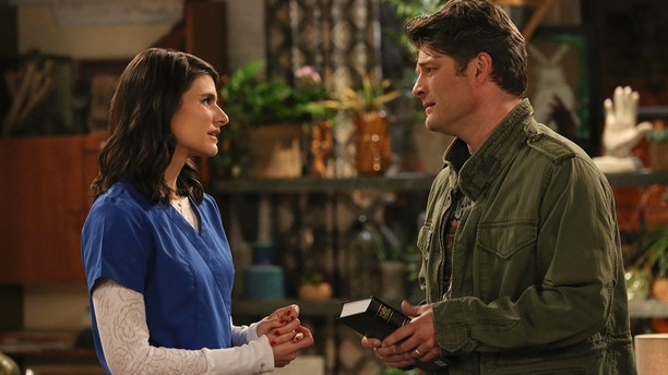 Pilot -- Upon learning that Leslie is expecting, Chip goes to the bookstore seeking parenting guidance, and stumbles upon a bible which inspires him to begin living strictly by the book, on the series premiere of LIVING BIBLICALLY, Monday, Feb 26 (9:30-10:00 PM, ET/PT) on the CBS Television Network.  Pictured L-R: Lindsey Kraft as Leslie and Jay R. Ferguson as Chip Photo: Michael Yarish/CBS ©2017 CBS Broadcasting, Inc. All Rights Reserved