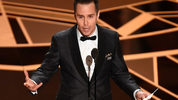 "Sam Rockwell accepts the award for best performance by an actor in a supporting role for ""Three Billboards Outside Ebbing, Missouri"" at the Oscars on Sunday, March 4, 2018, at the Dolby Theatre in Los Angeles."