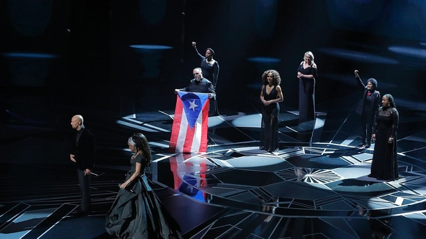 90th Academy Awards - Oscars Show - Hollywood, California, U.S., 04/03/2018 - A Puerto Rican flag is displayed as Andra Day and Common sing Best Original Song nominee Stand Up for Something from Marshall. REUTERS/Lucas Jackson - HP1EE3509M8XE