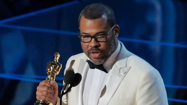 "90th Academy Awards - Oscars Show - Hollywood, California, U.S., 04/03/2018 - Jordan Peele accepts the Oscar for Best Original Screenplay for ""Get Out."" REUTERS/Lucas Jackson - HP1EE350A7AZK"