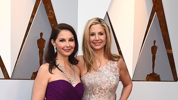 Ashley Judd, left, and Mira Sorvino arrive at the Oscars on Sunday, March 4, 2018, at the Dolby Theatre in Los Angeles. (Photo by Jordan Strauss/Invision/AP)