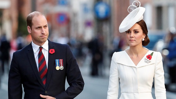 Britain's Prince William, the Duke of Cambridge, his wife Princess Kate, the Duchess of Cambridge make their way to the Last Post ceremony at the Menin Gate to mark the centenary of Passchendaele, The Third Battle of Ypres, in Ypres, Belgium July 30, 2017.  REUTERS/Yves Herman - RC1BE7369330