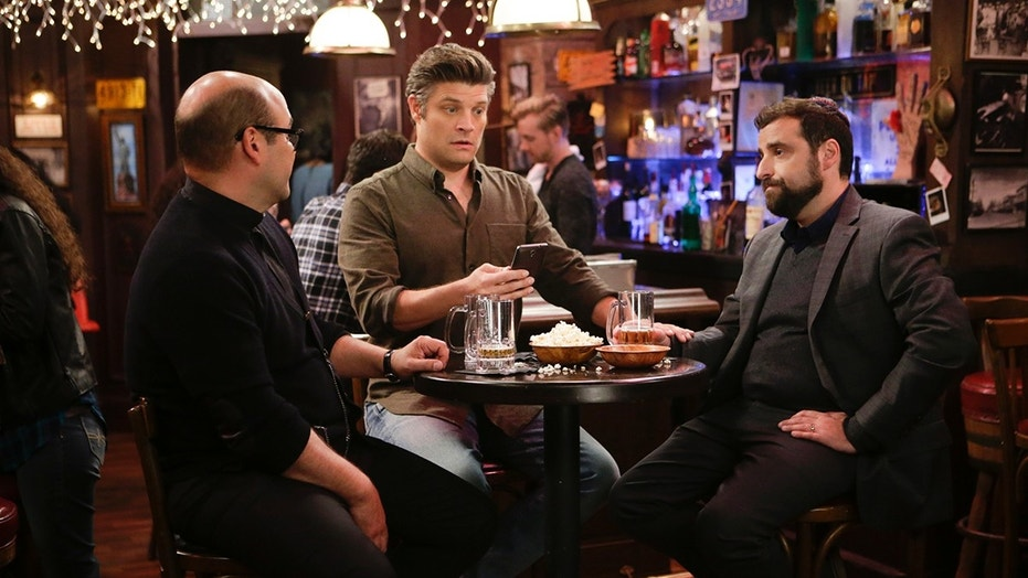 """False Idol$"" -- When Father Gene and Rabbi Gil (the ""God Squad"") point out to Chip that his addiction to his smartphone is the same as worshiping a false idol, Chip decides to stop using it, causing his wife, Leslie, and his officemates to worry about his whereabouts, on LIVING BIBLICALLY, Monday, March 5 (9:30-10:00 PM, ET/PT) on the CBS Television Network. Pictured L-R: Ian Gomez as Father Gene, Jay R. Ferguson as Chip, and David Krumholtz as Rabbi Gil Photo: Sonja Flemming/CBS ©2017 CBS Broadcasting, Inc. All Rights Reserved"
