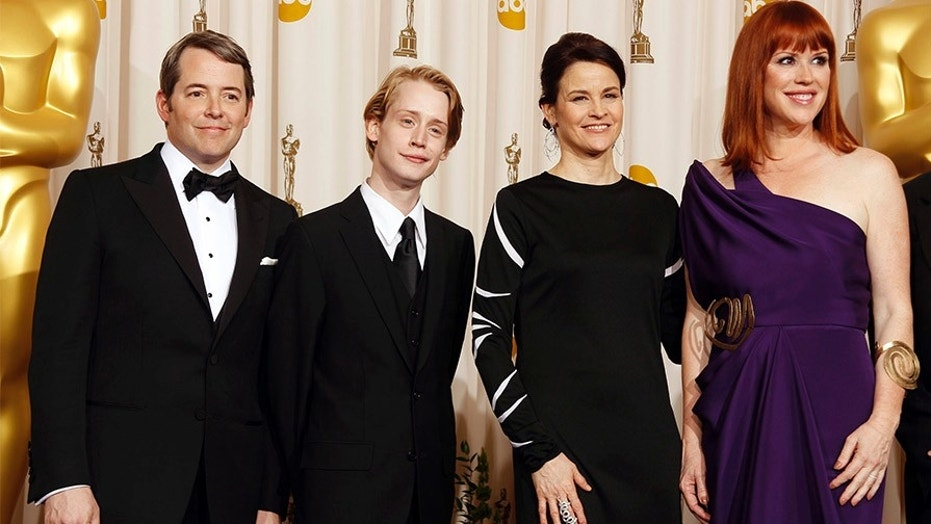 Actors (L-R) Matthew Broderick, Macaulay Culkin, Ally Sheedy and Molly Ringwald pose for photographers after participating in a tribute to director John Hughes at the the 82nd Academy Awards in Hollywood March 7, 2010.