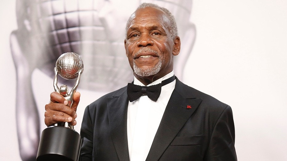 Danny Glover, the 71-year-old actor, was shouted down by heckling activists at a rally for Airbnb hosts Tuesday in the New York state Capitol.