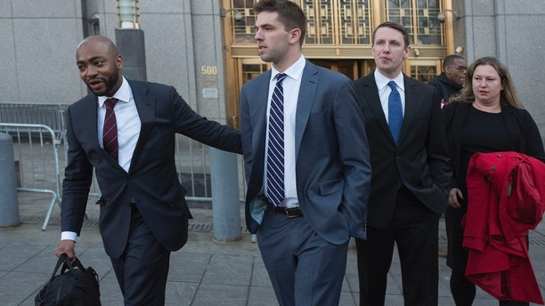 Billy McFarland, center, accompanied by his attorney Randall Jackson, left, leaves federal court after pleading guilty to wire fraud charges, Tuesday, March 6, 2018, in New York. The promoter of the failed Fyre Festival in the Bahamas faces a sentence of 8 to 10 years. (AP Photo/Mark Lennihan)