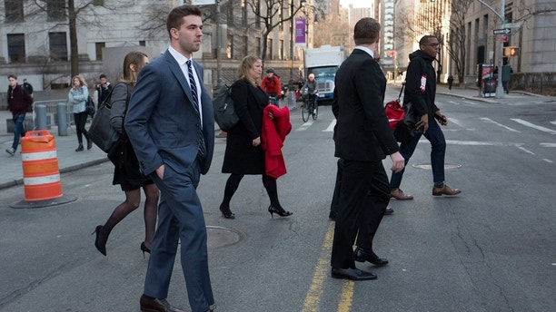 Billy McFarland, left, the promoter of the failed Fyre Festival in the Bahamas, leaves federal court after pleading guilty to wire fraud charges, Tuesday, March 6, 2018, in New York. He faces a sentence of 8 to 10 years. (AP Photo/Mark Lennihan)