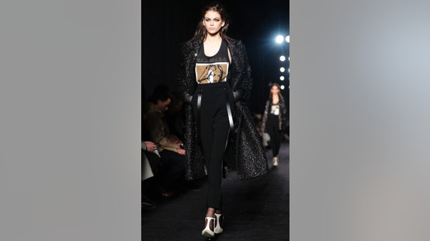 Model Kaia Gerber wears a creation as part of the Max Mara women's Fall/Winter 2018-2019 collection, presented during the Milan Fashion Week, in Milan, Italy, Thursday, Feb. 22, 2018. (AP Photo/Antonio Calanni)