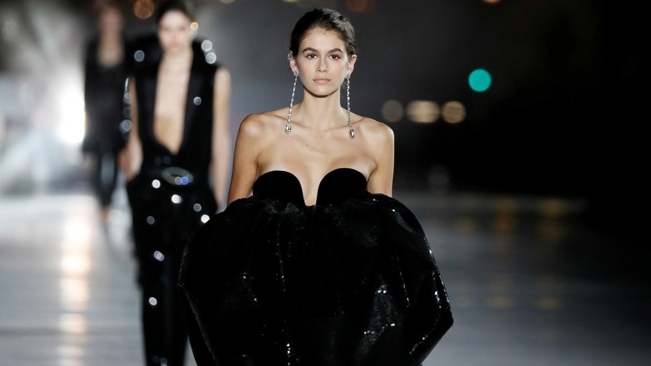 Model Kaia Gerber presents a creation by designer Anthony Vaccarello as part of his Spring/Summer 2018 women's ready-to-wear collection show for fashion house Saint Laurent during Paris Fashion Week, France, September 26, 2017. Picture taken September 26, 2017.