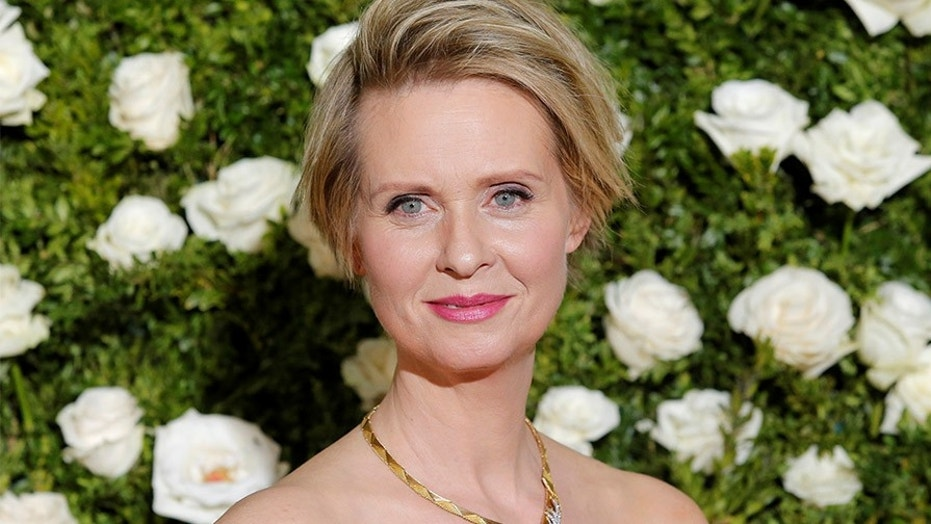 Actress Cynthia Nixon arrives at the 71st annual Tony Awards.
