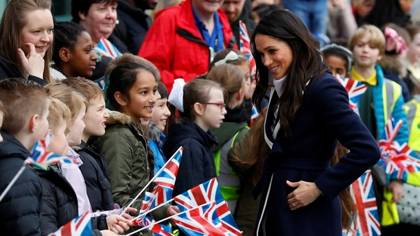 Meghan Markle talks to local school children during a walkabout with Britain's Prince Harry during a visit to Birmingham, Britain, March 8, 2018. REUTERS/Phil Noble - RC1F9FC6EE10