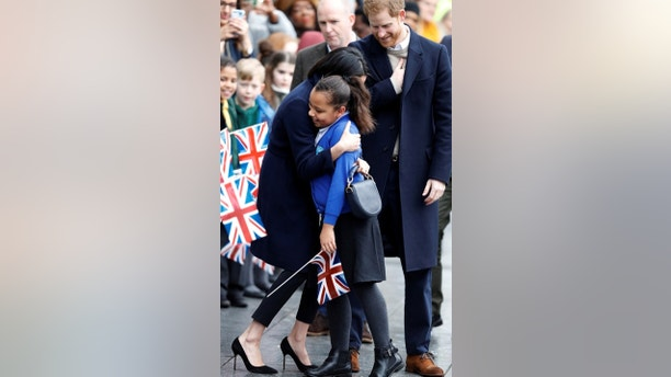Meghan Markle meets local school children during a walkabout on a visit with Britain's Prince Harry to Birmingham, Britain, March 8, 2018. REUTERS/Phil Noble - RC195FA546A0