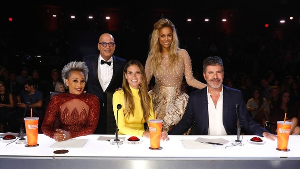 "AMERICA'S GOT TALENT -- ""Live Finale Results"" Episode 1224 -- Pictured: (l-r) Mel B, Howie Mandel, Heidi Klum, Tyra Banks, Simon Cowell -- (Photo by: Trae Patton/NBC)"