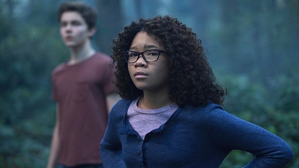 "This image released by Disney shows Storm Reid, right, and Levi Miller in a scene from ""A Wrinkle In Time."" (Atsushi Nishijima/Disney via AP)"