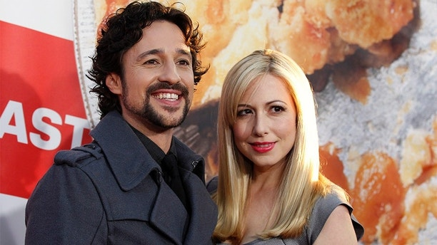 """Cast member Thomas Ian Nicholas and his wife Colette pose at the premiere of """"American Reunion"""" at the Grauman's Chinese theatre in Hollywood, California March 19, 2012. The movie opens in the U.S. on April 6.  REUTERS/Mario Anzuoni  (UNITED STATES - Tags: ENTERTAINMENT) - GM1E83K10FX01"""