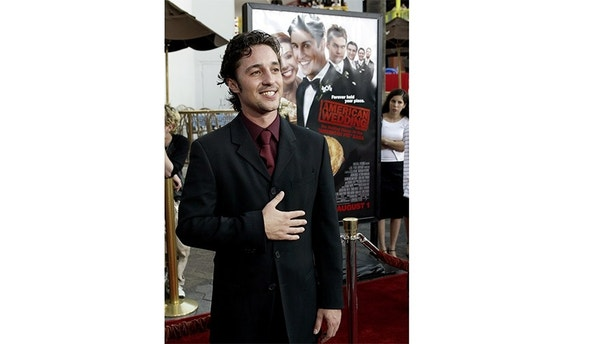 """Cast member Thomas Ian Nicholas arrives on the red carpet for the worldpremiere of the film """"American Wedding"""" in Universal City, CaliforniaJuly 24, 2003. Nicholas stars in the comedy that opens August 1 in theUnited States. REUTERS/Robert GalbraithRG - RP4DRHYLRIAB"""