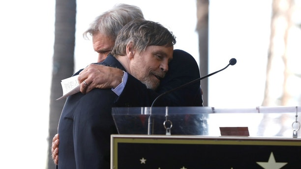Actor Harrison Ford embraces actor Mark Hamill (L) before unveiling his star on the Hollywood Walk of Fame in Los Angeles, California, U.S., March 8, 2018. REUTERS/Mario Anzuoni - RC1F33827320