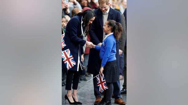 Meghan Markle talks to a local schoolgirl during a walkabout with Britain's Prince Harry during a visit to Birmingham, Britain, March 8, 2018. REUTERS/Phil Noble - RC1C2964AB20