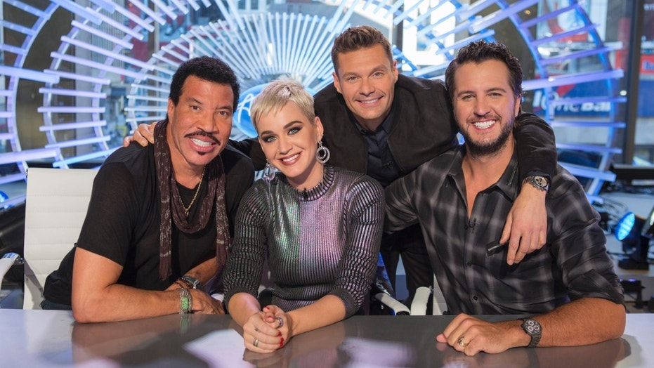 """Image released by ABC shows, from left, Lionel Richie, Katy Perry, Ryan Seacrest and Luke Bryan in New York. Richie, Perry and Bryan are the judges on the next season of """"American Idol,"""" premiering March 11 on ABC."""