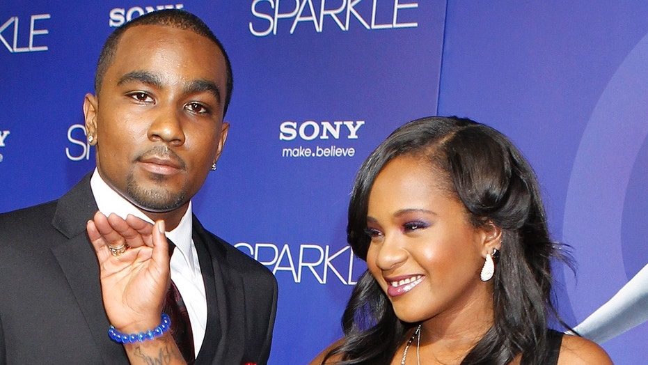 """Bobbi Kristina Brown, daughter of the late singer Whitney Houston, waves while arriving with boyfriend Nick Gordon at the premiere of the new film """"Sparkle"""", in Hollywood, California August 16, 2012. REUTERS/Fred Prouser/File Photo - TM3EC9G15JR01"""