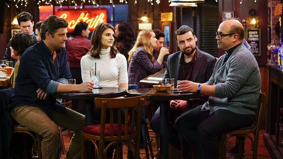 """Love Thy Neighbor"" -- After several sleepless nights due to loud neighbors, Chip asks Rabbi Gil and Father Gene for advice on loving thy neighbor, on LIVING BIBLICALLY, Monday, March 12 (9:30-10:00 PM, ET/PT) on the CBS Television Network. Pictured L-R: Jay R. Ferguson as Chip, Lindsey Kraft as Leslie, David Krumholtz as Rabbi Gil, and Ian Gomez as Father Gene Photo: Sonja Flemming/CBS ©2017 CBS Broadcasting, Inc. All Rights Reserved"