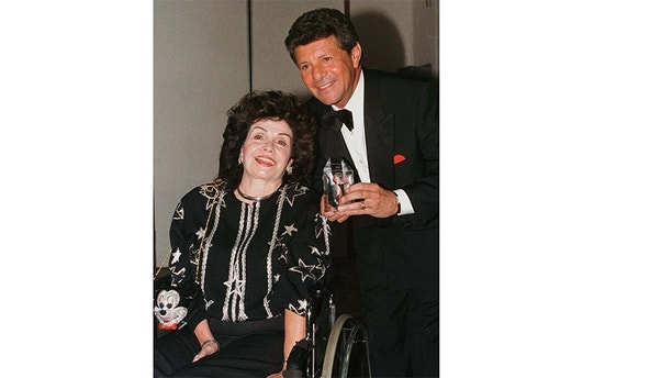 Actress Annette Funicello poses with singer Frankie Avalon September 14 at the Southern California chapter of the National Multiple Sclerosis Society's Dinner of Champions in Los Angeles. Funicello, who is afflicted with multiple sclerosis, received a special tribute at the event which also honored Walt Disney Studios chairman Joe Roth.