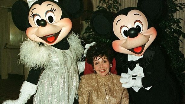 "Actress Annette Funicello poses with Disney characters ""Minnie Mouse "" (L) and ""Mickey Mouse"" during a VIP reception February 15 prior to a benefit dinner hosted by the charity organization ""Women in Show Business...for children"", which honored the actress. Funicello, best known as a member of the ""Mickey Mouse Club,"" suffers from multiple sclerosis.