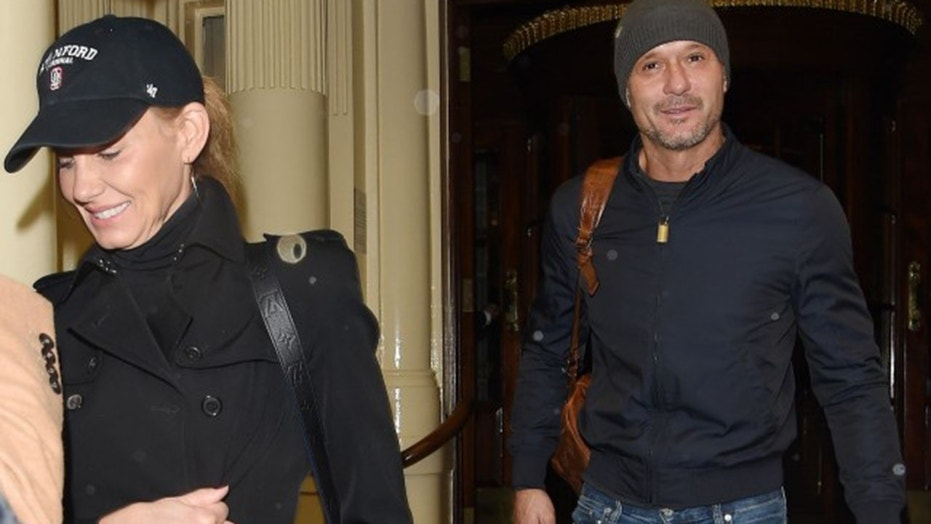 Tim McGraw (right) stepped out with wife Faith Hill in his first public sighting since he collapsed onstage mid-show.