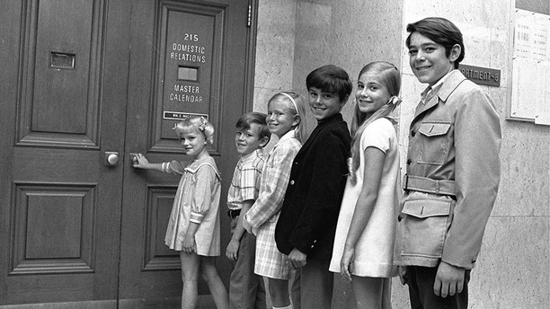 """Six youngsters who only recently met line up outside a Los Angeles, Ca. courtroom June 18, 1969 to await approval of contracts calling for them to play brothers and sisters on a new television series.  The series, called """"The Brady Bunch,"""" is about a widower with three boys who marries a widow with three girls and will premiere on ABC-TV in September.  Left to right:  Susan Olsen, 8; Michael Lookinland, 8 1/2; Eve Plumb, 11; Christopher Knight, 11; Maureen McCormick, 12; Barry Williams, 14. (AP Photo)"""