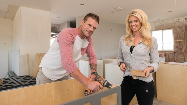 """Aubrey (R), helps Bristol (L), assemble their cabinets prior to installing them in their new kitchen, as seen on """"Flip or Flop Las Vegas."""""""