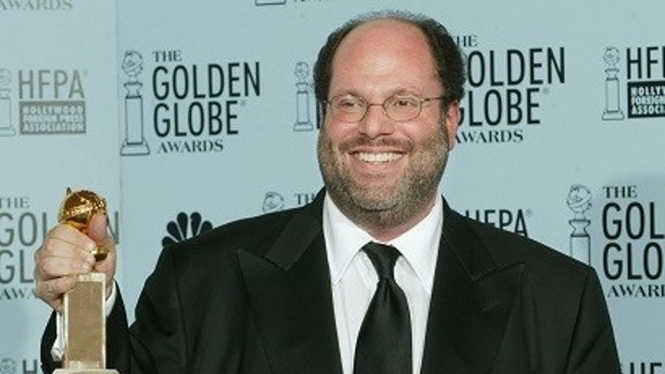"""Producer Scott Rudin holds his best drama motion picture award he won for his film """"The Hours"""" at the 60th annual Golden Globe Awards in Beverly Hills, California, January 19, 2003. REUTERS/Andy Clark  BS/SV - RP3DRINHPEAA"""