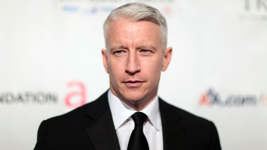 Anderson Cooper arrives at a benefit dinner for the Elton John Aids Foundation in New York, Nov. 16, 2009.