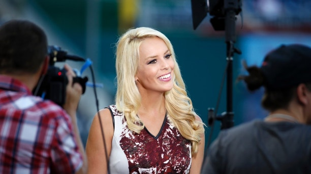 FILE - In this Sept. 8, 2015, file photo, ESPN television reporter Britt McHenry smiles before a baseball game between the Washington Nationals and the New York Mets at Nationals Park in Washington. McHenry tells Marie Claire in an article published online Dec. 12, 2016, that stress over a viral video that showed her hurling personal insults toward a towing company clerk may have led to a condition that caused permanent eye damage. (AP Photo/Alex Brandon, File)