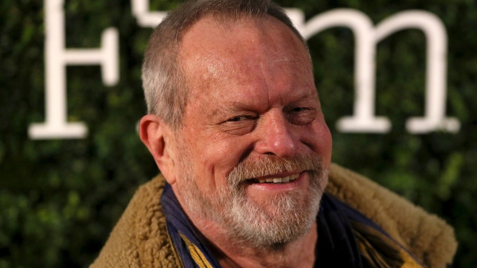 U.S. director Terry Gilliam poses for photographers at the Evening Standard British Film Awards in London, Britain February 7, 2016.