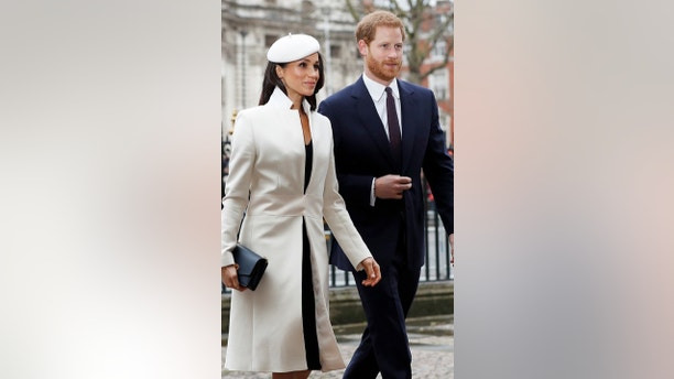 Britain's Prince Harry and his fiancee Meghan Markle arrive at the Commonwealth Service at Westminster Abbey in London, Britain, March 12, 2018. REUTERS/Peter Nicholls - RC17E4C0B880