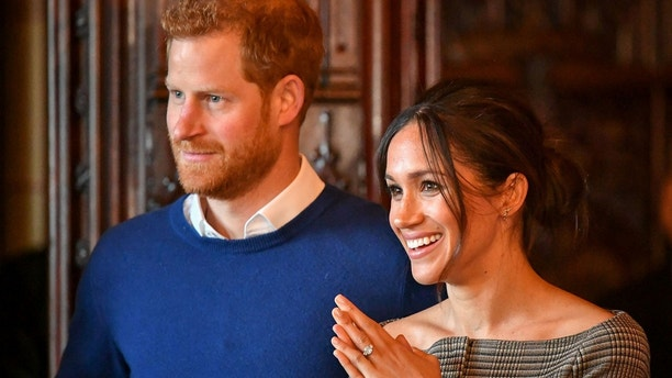 Britain's Prince Harry and his fiancee Meghan Markle watch a performance by a Welsh choir in the banqueting hall during a visit to Cardiff Castle in Cardiff, Britain, January 18, 2018. REUTERS/Ben Birchall/Pool - RC1636DB6690
