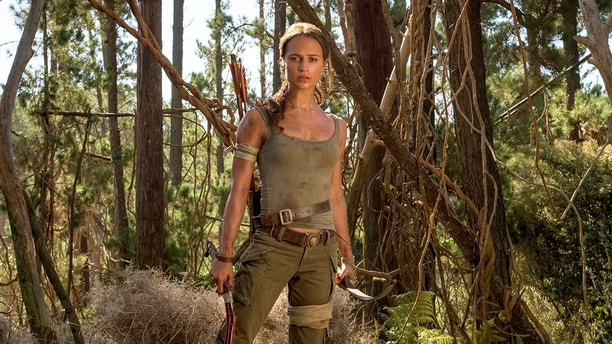 """This image released by Warner Bros. Pictures shows Alicia Vikander in a scene from """"Tomb Raider."""" It took weeks of training and plates full of protein to turn former ballerina Alicia Vikander into action star Lara Croft. (Graham Bartholomew/Warner Bros. Pictures via AP)"""