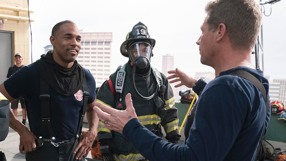 """Jason George, left, stars in the latest """"Grey's Anatomy"""" spinoff """"Station 19."""""""