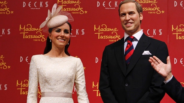 Wax figures of Britain's Prince William and his wife Catherine, Duchess of Cambridge, are displayed during a media briefing for the opening of the Madame Tussauds Tokyo wax museum, in Tokyo November 28, 2012. The Madame Tussauds Tokyo wax museum will open to public in March 2013. REUTERS/Issei Kato (JAPAN - Tags: ENTERTAINMENT SOCIETY ROYALS TRAVEL) - GM1E8BS101Q01