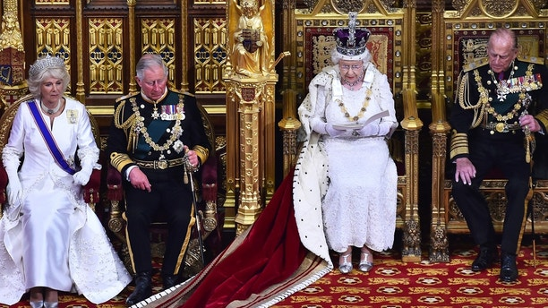 Britain's Queen Elizabeth delivers the Queen's Speech next to Prince Phillip and flanked by Prince Charles and his wife Camilla during the State Opening of Parliament in the Palace of Westminster in London, Britain, May  27, 2015. REUTERS/Ben Stansall/Pool - LR2EB5R101C5T