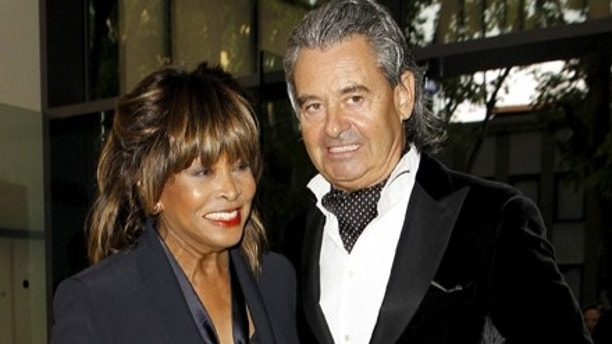 U.S. pop singer Tina Turner pose with her husband Erwin Bach before Giorgio Armani's fashion show to celebrate 40th anniversary of his career and to mark the opening of the Expo 2015 in Milan, April 30, 2015. The Milan Expo will open in the city on May 1, following the 2010 Shanghai Expo. Officials are counting on some 20 million visitors to the six month-long exhibition of products and technologies from around the world. REUTERS/Alessandro Garofalo  - GF10000079008