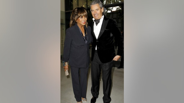 U.S. pop singer Tina Turner pose with her husband Erwin Bach before Giorgio Armani's fashion show to celebrate 40th anniversary of his career and to mark the opening of the Expo 2015 in Milan, April 30, 2015. The Milan Expo will open in the city on May 1, following the 2010 Shanghai Expo. Officials are counting on some 20 million visitors to the six month-long exhibition of products and technologies from around the world. REUTERS/Alessandro Garofalo