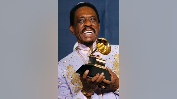 Ike Turner poses with his Grammy for Best Traditional Blues Album for 'Risin With the Blues' at the 49th Annual Grammy Awards in Los Angeles February 11, 2007.     REUTERS/Mike Blake    (UNITED STATES) - GM1DUPAOJCAA