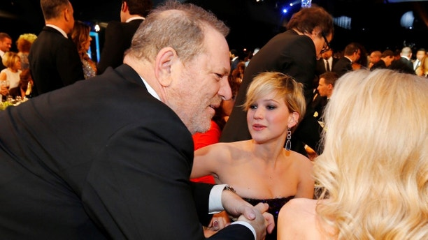 Producer Harvey Weinstein speaks with Jennifer Lawrence (C) during a commercial break at the 20th annual Screen Actors Guild Awards in Los Angeles, California January 18, 2014   REUTERS/Mike Blake  (UNITED STATES  Tags: ENTERTAINMENT)(SAGAWARDS-SHOW) - TB3EA1J07IQ42