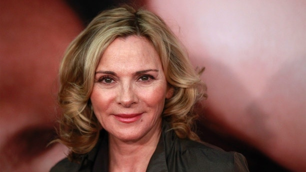 "Actress Kim Cattrall arrives for the premiere of the film ""The Five-Year Engagement"" to begin the 2012 Tribeca Film Festival in New York, April 18, 2012. The premiere of the film starring Jason Segel and Blunt, by the same team behind ""Forgetting Sarah Marshall,"" kicked off the festival which is entering its second decade with organizers promising a broader quality of films from all regions of the world. REUTERS/Lucas Jackson (UNITED STATES - Tags: ENTERTAINMENT) - GM1E84J0WKP01"