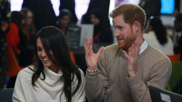Britain's Prince Harry and his fiancee Meghan Markle attend an event at Millennium Point to celebrate International Women's Day in Birmingham, Britain, March 8, 2018. REUTERS/Ian Vogler/Pool - RC1F0D82E970